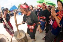 Phutai minority woman pounding rice. KALASIN,THAILAND-MARCH 9 : Unidentified Phutai minority senior woman competitive pounding rice fun and happiness in The 2nd Royalty Free Stock Photos