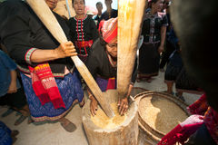 Phutai minority woman pounding rice. KALASIN,THAILAND-MARCH 9 : Unidentified Phutai minority senior woman competitive pounding rice fun and happiness in The 2nd Stock Photo