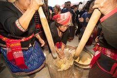 Phutai minority woman pounding rice. KALASIN,THAILAND-MARCH 9 : Unidentified Phutai minority senior woman competitive pounding rice fun and happiness in The 2nd Stock Photography