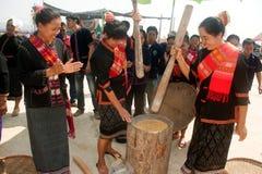 Phutai minority woman pounding rice. KALASIN,THAILAND-MARCH 9 : Unidentified Phutai minority senior woman competitive pounding rice fun and happiness in The 2nd Stock Images