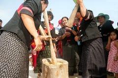 Phutai minority woman pounding rice. KALASIN,THAILAND-MARCH 9 : Unidentified Phutai minority senior woman competitive pounding rice fun and happiness in The 2nd Stock Image