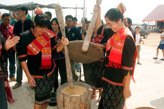 Phutai minority woman pounding rice. KALASIN,THAILAND-MARCH 9 : Unidentified Phutai minority senior woman competitive pounding rice fun and happiness in The 2nd Royalty Free Stock Images