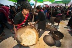 Phutai minority woman pounding and winnowing rice. KALASIN,THAILAND-MARCH 9 : Group of unidentified Phutai minority senior woman competitive pounding and Stock Photos