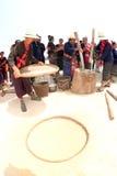 Phutai minority woman pounding and winnowing rice. Stock Photos