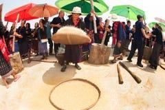 Phutai minority woman pounding and winnowing rice. KALASIN,THAILAND-MARCH 9 : Group of unidentified Phutai minority senior woman competitive pounding and Royalty Free Stock Image