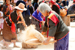 Phutai minority woman pounding and winnowing rice. KALASIN,THAILAND-MARCH 9 : Group of unidentified Phutai minority senior woman competitive pounding and Royalty Free Stock Photo