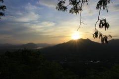PhuThok med soluppgång Arkivbilder