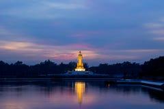 Twilight sky and Buddha statue at PhutthamonthonBuddhist park in Nakhon Pathom Province of Thailand. Phutthamonthon is a Buddhist park in Phutthamonthon district Stock Image