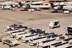 PHX airport. Luggage and carts on the ramp. Stock Photography