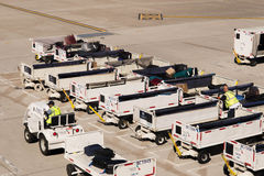 PHX airport. Luggage and carts on the ramp. Royalty Free Stock Photos