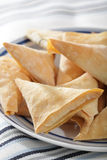 Phyllo triangles. With cottage cheese on the plate Royalty Free Stock Photos