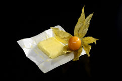 Physalis and butter Royalty Free Stock Images