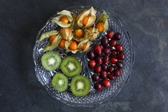 Physalis fruit - Cape gooseberries with cranberries and kiwi stock photo