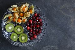 Physalis fruit - Cape gooseberries with cranberries and kiwi stock image
