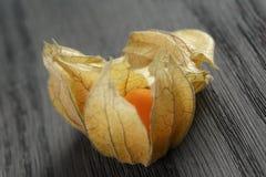 Physalis fruit on oak wooden table Stock Photography