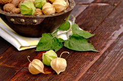 Physalis fruits. On top of old wooden table Stock Photo