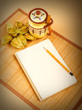 Physalis fruits, ceramic sugar bowl and a notebook on a bamboo n. Apkin Royalty Free Stock Photos