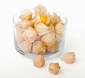 Physalis in a glass bowl on white background Royalty Free Stock Photo