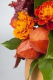 Physalis and marigolds Stock Photos