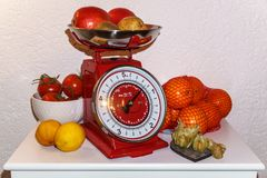 Physalis and other fruits on scale royalty free stock photo