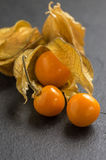 Physalis on slate plate Stock Photo