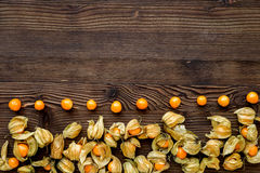 Physalis on wooden background top view mock up Stock Photos
