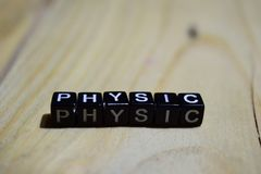 Physic written on wooden blocks. Inspiration and motivation concepts. stock image