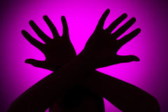 Physical abuse. Concept on a pink background Royalty Free Stock Photo