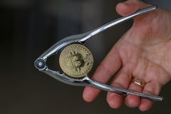 Physical bit coin. Bitcoin. Physical bit coin. Digital currency. Cryptocurrency Stock Photography