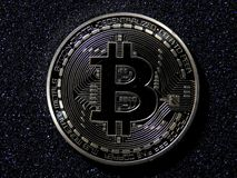 Physical bitcoin. A physical bitcoin on dark background Royalty Free Stock Images