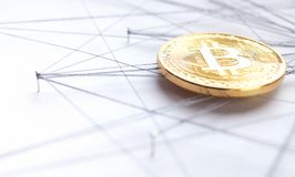 Block chain technology visualization. Physical Bitcoin suspended in sewing thread and pins  blockchain network concept, low angle close up Stock Photo