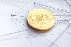 Block chain technology visualization. Physical Bitcoin suspended in sewing thread and pins isolated blockchain network concept Stock Image