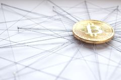 Block chain technology visualization. Physical Bitcoin suspended in sewing thread and pins isolated blockchain network concept, low angle close up Royalty Free Stock Photos