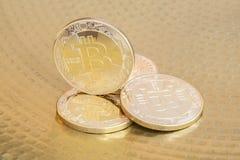 Physical bitcoins on golden background. Physical bitcoin coins on golden background Royalty Free Stock Photos