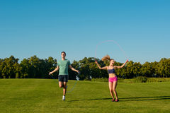 Physical education on a green meadow. Royalty Free Stock Image