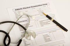 Physical examintaion form with stethoscope and pen Stock Photo