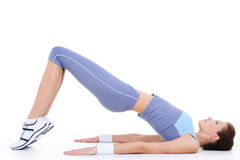 Physical exercise on the floor by young woman Royalty Free Stock Image