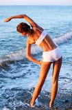 Physical exercises on the beach. Royalty Free Stock Photo