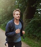 Physical Fit Man Running at the Park Alone Stock Image