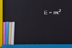 Physical Formula. Albert Einsteins Physical Formula on Blackboard with Colourful Chalks Stock Image