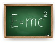Physical formula on blackboard Stock Photography