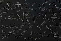 Physical formulas on a blackboard Royalty Free Stock Photos