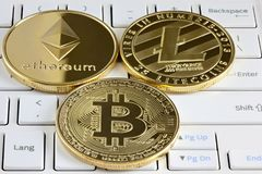 Bitcoin, Ethereum and Litecoin on the keyboard. Royalty Free Stock Photo