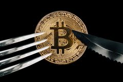 Physical Golden Crytocurrency Coin under fork and knive. Currency of the future. Bitcoin representing food Stock Photos