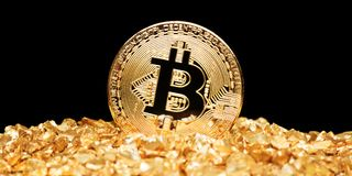 Bitcoin is new gold. Physical golden representation of virtual cryptocurrency bitcoin Stock Photo