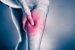 Physical injury, calf leg pain. Calf pain, physical injury. Male leg and muscle pain from running or training, sport physical injuries when working out. Man Stock Photography