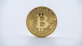 Physical metal golden Bitcoin currency, white background. Cryptocurrency royalty free stock images