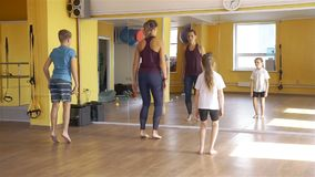 Physiotherapist doing exercises with children stock video footage