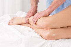 Physical therapist doing lymphatic drainage. For the legs Royalty Free Stock Photos