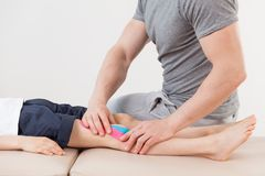 Physical therapist doing massage Royalty Free Stock Image